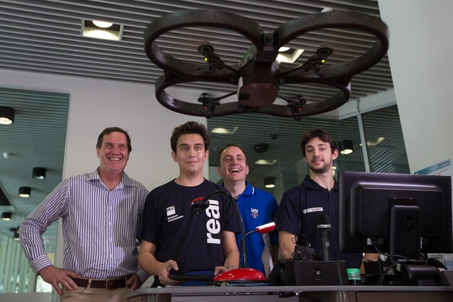 l-r  Dr Anthony Lynham -  Minister for State Development and Minister for Natural Resources and Mines, QUT Student Ambassador David Crofts, QUT Professor  Jonathan Roberts - Professor in Robotics and Filippo Capurso, First Year Mechatronics student. (Picture: Patrick Hamilton)